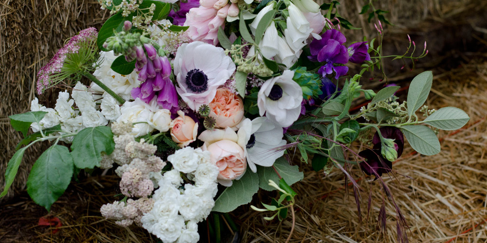 farmer florist purple brides bouquet spring anemones roses sweetpeas