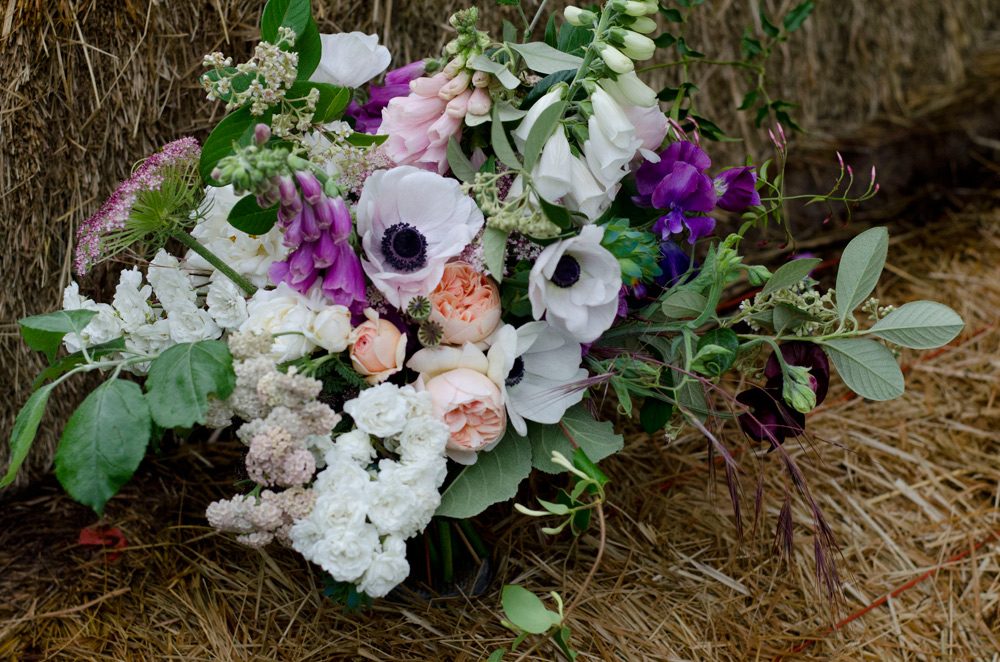 farmer florist purple brides bouquet spring anemones roses sweetpeas