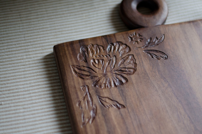 handcarved floral design walnut wood cutting board or cheese board inspired by ariele alasko