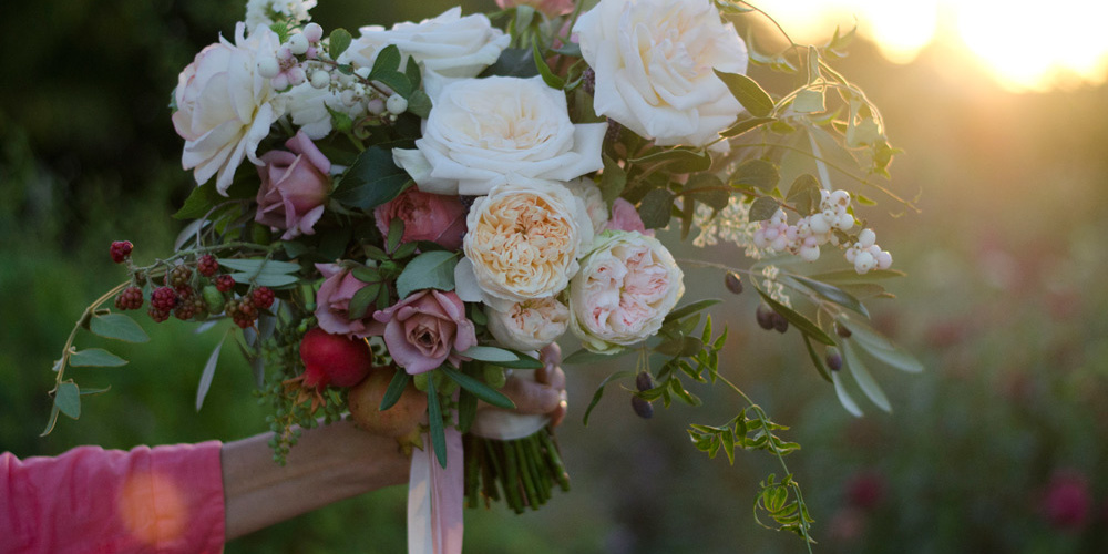 garden roses and poemegranate wedding bouquet sacramento florist